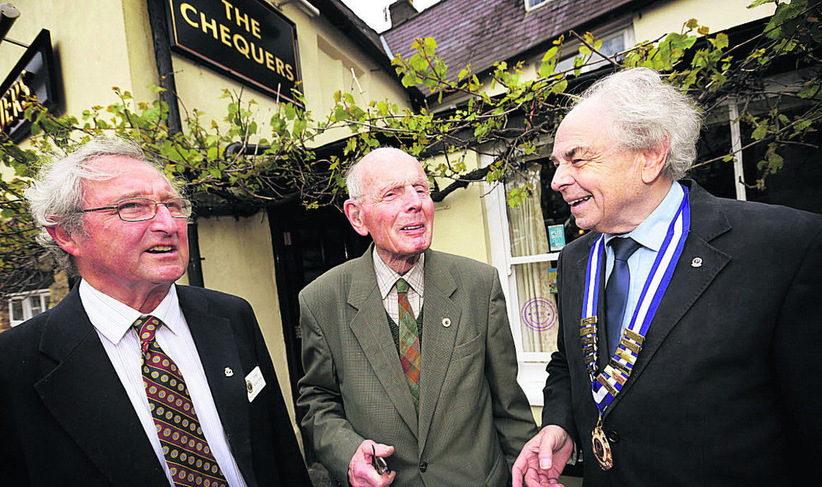 Dr Bruce Parker MBE, centre, who founded the group 25 years ago with former chairman Tony Backer-Holst, left, and current chairman Tony Clark outside The Chequers where the group still attend