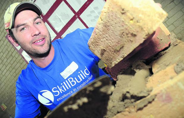 Stuart Bevan demonstrates bricklaying