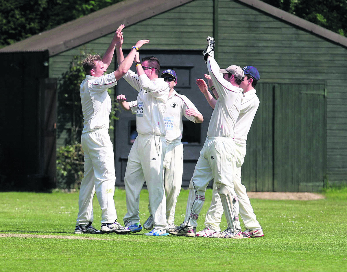 Great & Little Tew's Matt Woods is mobbed by his teammates after trapping George Seacole lbw against Shipton-under-Wychwood