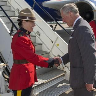Witney Gazette: The Prince of Wales shakes hands with Canadian protection officer, Police Inspector Marie-Claude Cote on departure from RAF Brize Norton in Oxfordshire
