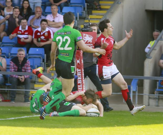 Witney Gazette: Stegmann touches down for Welsh as James Lewis leads his side's celebrations