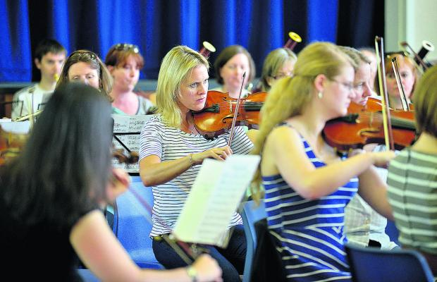 Yolanda Harrison, centre, and other members of Burford Orchestra playing at the town's secondary school