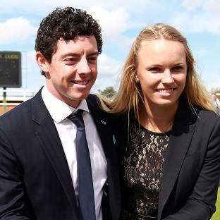 Witney Gazette: Golfer Rory McIlroy with former fiancee and tennis player Caroline Wozniacki in 2012