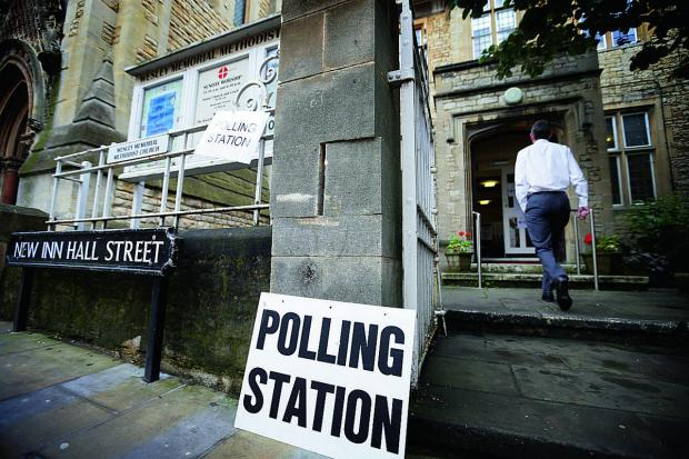 Witney Gazette: Voters arrive at Wesley Memorial Church polling station in Oxford city centre.     Picture: OX67321 Damian Halliwell