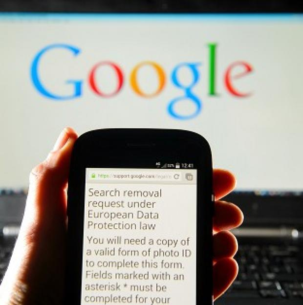 Witney Gazette: A Google search removal request displayed on the screen of a smart phone