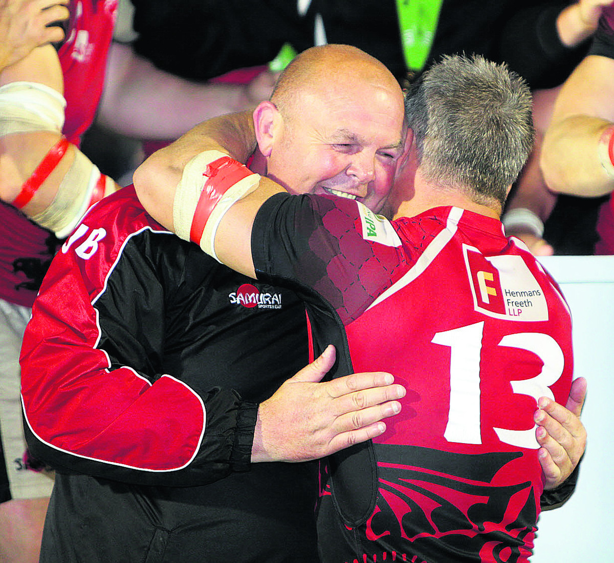London Welsh skipper Tom May hugs head coach Justin Burnell after their success at Bristol on Wednesday night which secured promotion back into the Aviva Premiership