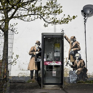 Banksy has confirmed he painted a mural depicting agents in Cheltenham.