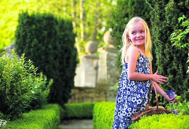 Isabella Potter helps to prepare the late Sir Hardy Amies's garden for the big day