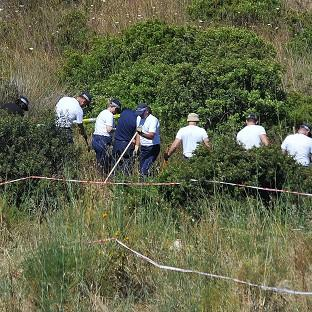 Witney Gazette: Police investigating the disappearance of Madeleine McCann in Portugal search a patch of scrubland