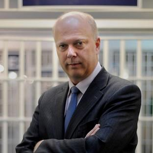 Justice Secretary Chris Grayling has defended moves to cope with an increase in prisoner numbers