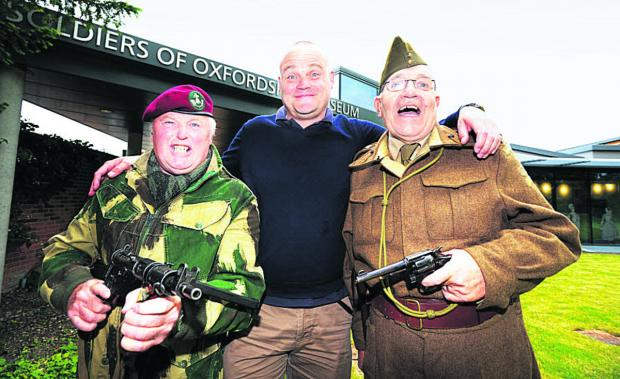 Witney Gazette: Al Murray, centre, with David Bayliss, left, dressed as a member of the glider-borne 2nd Bn Ox and Bucks Light Infantry and Brian Tegg as a Captain in the 2nd Bn Oxfordshire Home Guard