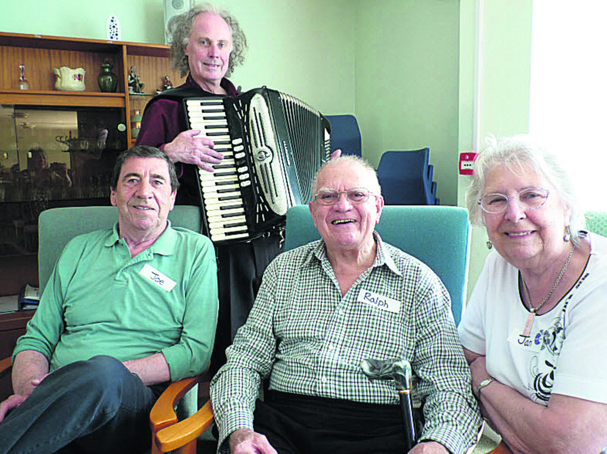 Musician Arne Richards is pictured with, from left, Joe Lambe, from Carterton, and Ralph and Jan Burrage