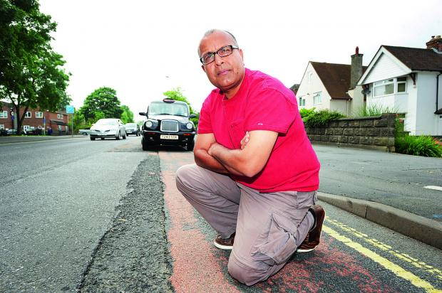 City councillor Saj Malik, a taxi driver, pictured on one of the 'gateways' into the city, London Road, where he says the potholes are a poor welcome for visitors. Picture: OX68073 Jon Lewis
