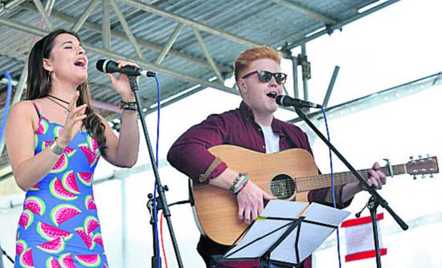 Witney Gazette: Jasmine and James on stage in Chipping Norton's Market Place