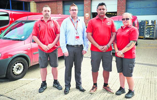 From left, postman Derek Clerkin, delivery office manager Scott Lovell, Steven Gill and postwoman Sam Prescott at Royal Mail's Oxpens office. Picture:OX68165 Cliff Hide