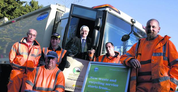 Witney Gazette: SHARED RESOURCE: Cllr David Harvey, cabinet member for environment at West Oxfordshire District Council, pictured with refuse staff, left to right, Gary Gill, Stan Kacbrzak, Roy Fennell, Andy Cracknell Mark Empson, pictured in 2010.