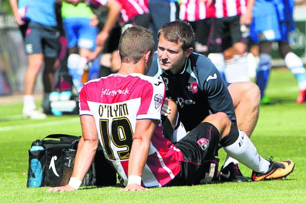 Witney Gazette: Andrew Proctor (right) in action as Exeter's physio