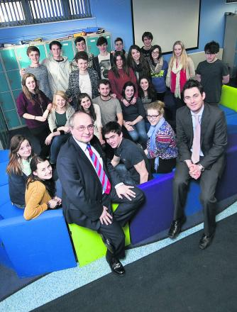 ISSUES: Wallingford School head Wyll Willis and his deputy Gwyn Williams with pupils who did well in their GCSEs last year to give the school the best results in the county
