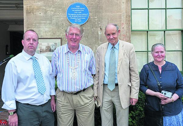 From left, Mark Whitely, John White, Emeritus Professor Robert Evans and Eda Forbes with the plaque