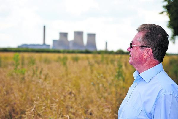 Witney Gazette: Neighbour Michael Jenkins looks towards Didcot Power Station