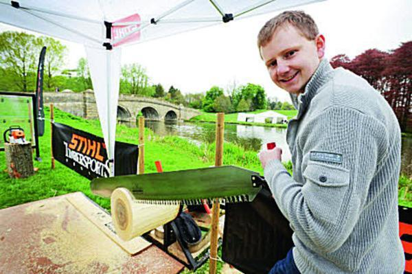 Witney Gazette: Dan Robinson sawing through a poplar log on the Stihl Timbersports stand