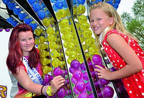 Left, deputy Carnival Queen Hollie Tuckey, 16, and attendant Brooke Patterson, eight