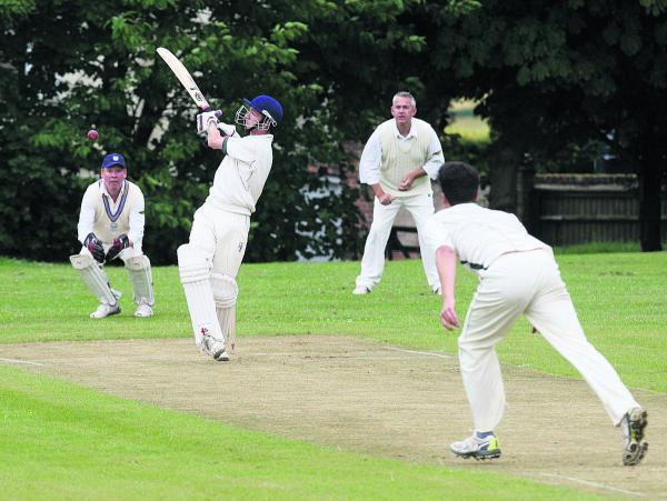 Hailey's Corey Kearsey smashes a four during their six-run win at Britwell Salome in Division 4 on Saturday