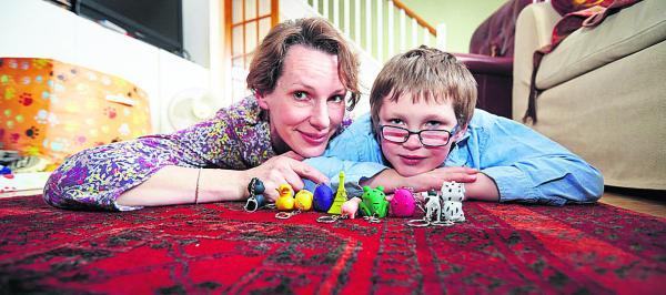 Alison Mercer with her seven-year-old son Tom, who has autism