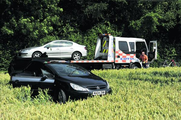 Jeremy Clarkson's black damaged Peugeot and James May's silver Peugeot on the back of a recovery truck after being pulled out of a ditch  Pictures: Mark Hemsworth