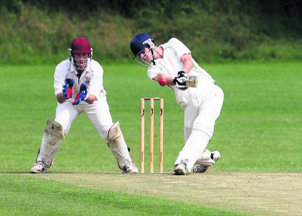 Witney Gazette: Combe's Ethan Chapman on his way to an unbeaten 73 in his side's 37-run home win against East & West Hendred in Division 2 on Saturday