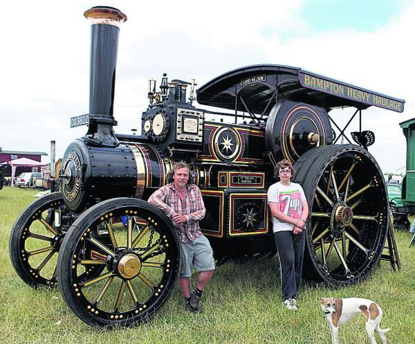 David Tomlins, from Bampton, and his son Arnie with their traction engine at last year's show