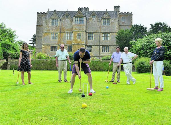 Andy Jones plays croquet at Chastleton House watched by, from left, Ruth Peters, David Taylor, Ben Jaques, Bob Hann and Pamela Taylor