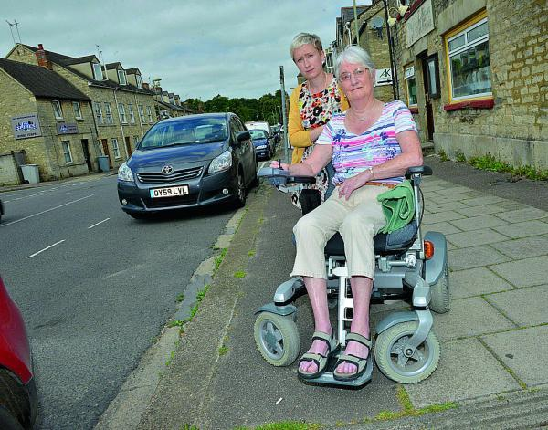 Unhappy with the new proposed parking arrangements in Witney are, from left, Councillor Laura Price and wheelchair user Sandy Slack. Picture: OX68674 Simon Williams