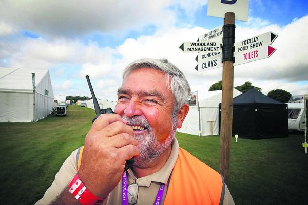 CLA Game Fair director Tony Wall keeps in touch with his team yesterday as the preparations entered the final day before the show opened to the public                                    Picture: OX68697 Damian Hal