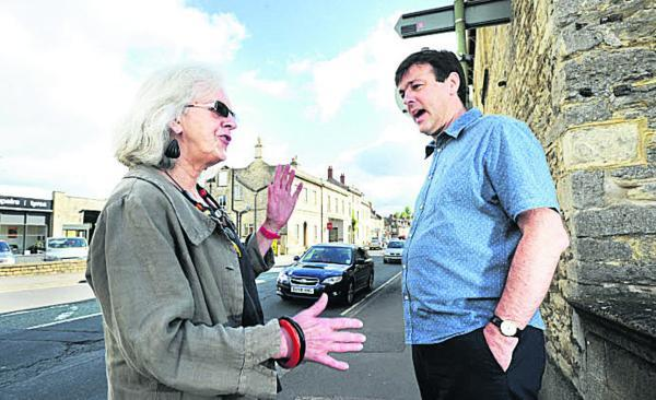 Kate Pollard, co-owner of Relics of Witney, and Duncan Enright discuss the proposed crossing