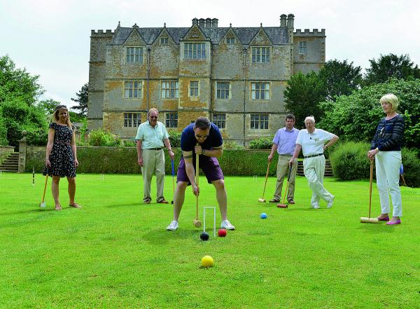 Andy Jones plays croquet at Chastleton House near Chipping Norton on croquet day, from back left to right, Ruth Peters, David Taylor, Ben Jaques,  Bob Hann, and Pamela Taylor. Pictures: OX68431 Simon Williams