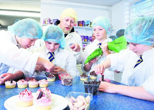 Children making cupcakes in the test bakery