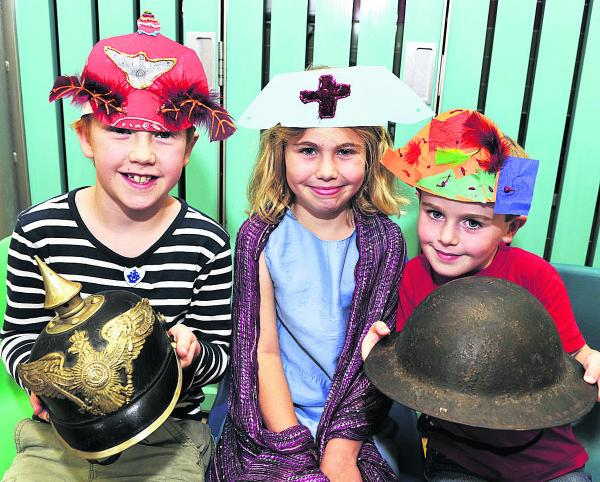 Adam Bradley, nine, with German Pickelhaube, Chloe Poulter, eight, with nurse's headress and Will Poulter, five,