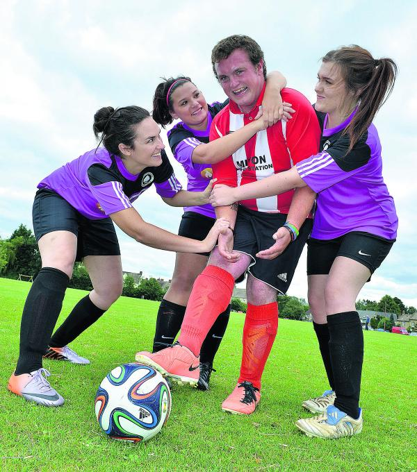Milton-under-Wychwood's Sam Austin finds himself surrounded by Wychwood Ladies ahead of Saturday's friendly. Putting him under pressure are, left to right,  Dee Loader, Kayleigh Fowler and Leah Hunt
