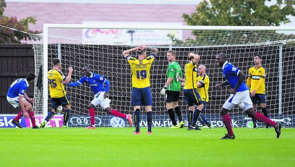 Oxford United's players cannot believe it as Craig Westcarr (third from left) wins it for Por