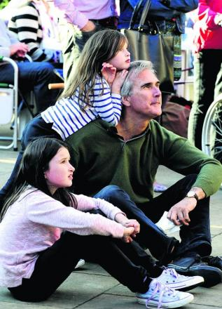 Gerard Hall enjoys the music with his daughters Lily, nine, left, and six-year-old Elsa
