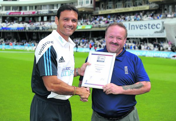 Martyn Cross receives his ECB award from  former England batsman Mark Ramprakash during the fifth Test match between England and India at The Oval.