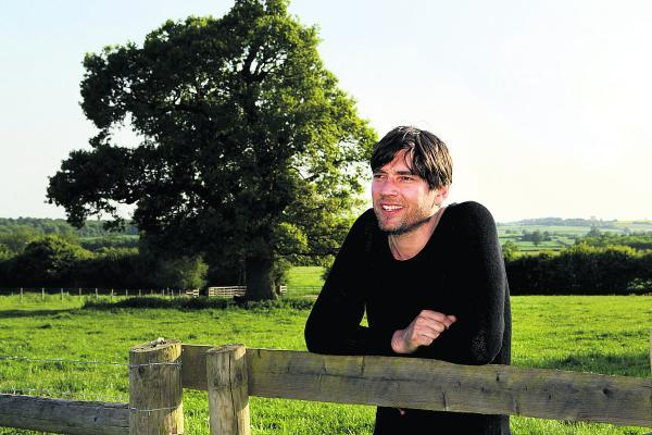 Big dreams:Alex James on his Oxfordshire farm where the three-day festival will take place