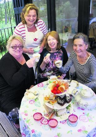 Sarah Plumridge, back, of Ruby Rue Teas, tempts the tastebuds of, from left, Denise Barkley, Gill Oliver and Helen Peacocke