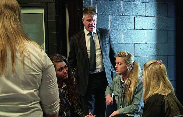Marcus Harris plays headteacher Brian Davis, centre, in the new series of Darton High