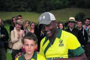 Young cricketer Dee Jarvis is presented with a signed shirt by Brian Lara at Sunday's charity match at Wormsley