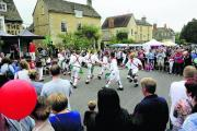 Charlbury and Finstock Morris perform for crowds at the Charlbury Street Fair on Saturday 		 	Picture: OX70117 David Fleming