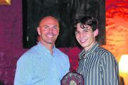 Paul Nixon gives the Witney Mills first XI player-of-the-year award to Sam Haselgrove