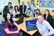 Sixth-formers Lily Fowler, front, left, and Ewan Houston, front, right, with, from left, Thomas Willoughby, head of sixth-form Rob Dorey, Hollie Hancock, executive headteacher Damian Booth, Iain Bilton, Braiden Davies, Susan Oliver and Becki Sanderson