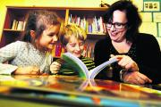 West Oxford Primary School headteacher Clare Bladen reading with pupils Rosie Gee and Frith Dixon, both seven